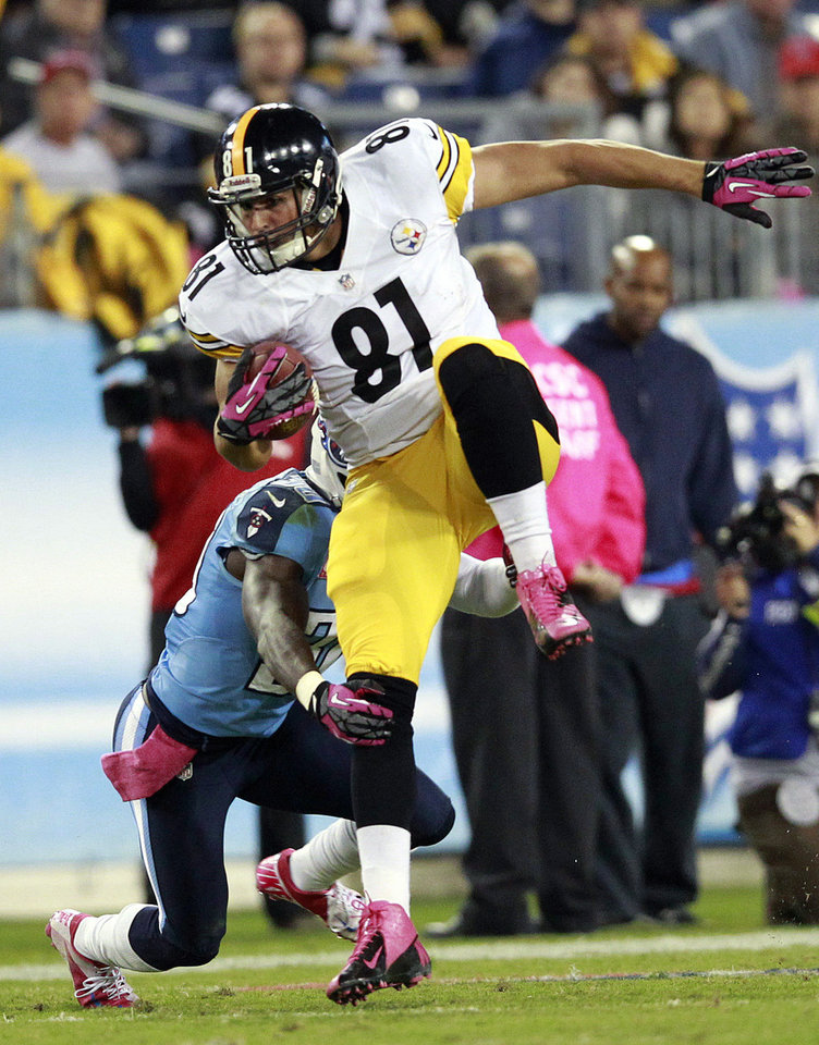 Pittsburgh Steelers tight end David Paulson (81) tries to break free from Tennessee Titans cornerback Jason McCourty during the second half of an NFL football game Thursday, Oct. 11, 2012, in Nashville, Tenn. (AP Photo/Wade Payne)