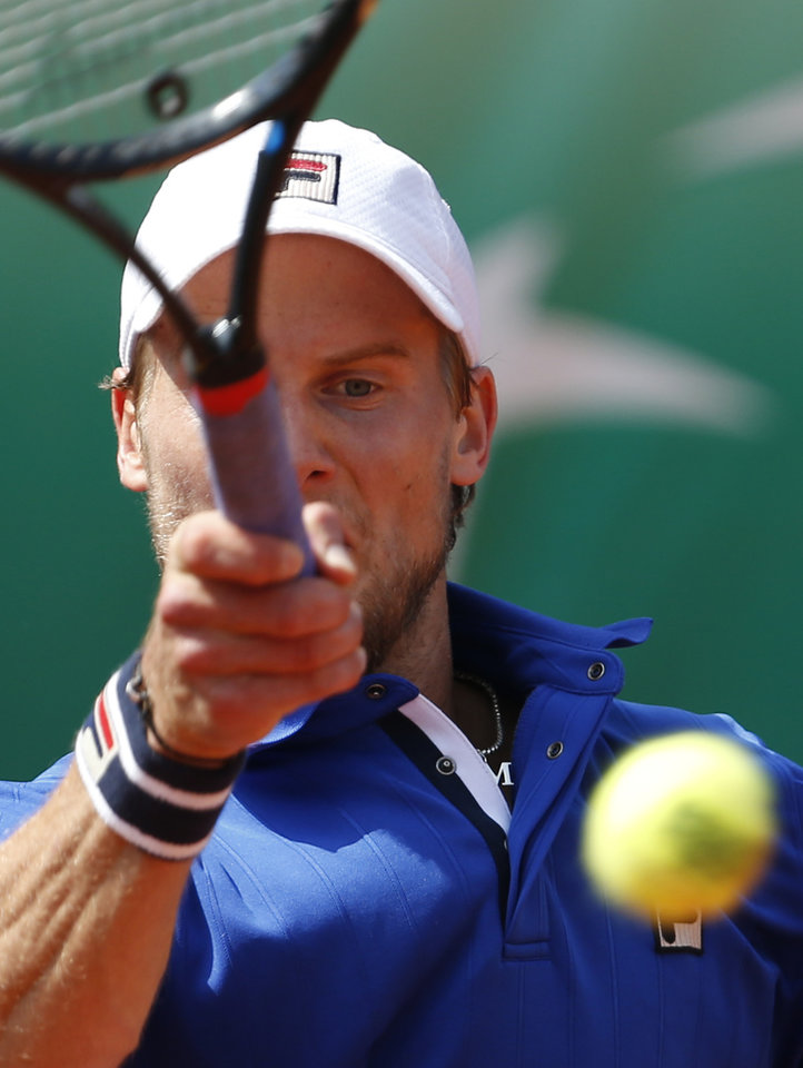 Photo - Italy's Andreas Seppi returns the ball to Spain's David Ferrer during the third round match of  the French Open tennis tournament at the Roland Garros stadium, in Paris, France, Saturday, May 31, 2014. (AP Photo/Darko Vojinovic)