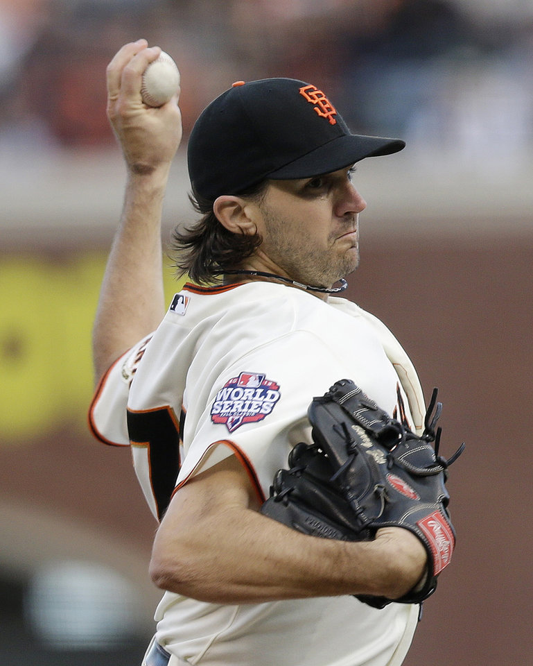 Photo -   San Francisco Giants' Barry Zito throws during the first inning of Game 1 of baseball's World Series against the Detroit Tigers Wednesday, Oct. 24, 2012, in San Francisco. (AP Photo/Marcio Jose Sanchez)