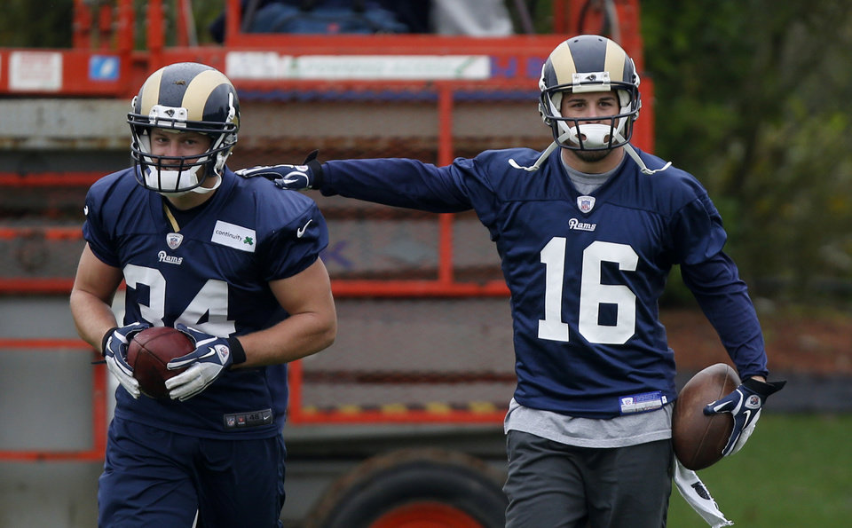 Photo -   St. Louis Rams' Chase Reynolds, left, and wide receiver Danny Amendola take part in an NFL training session at Arsenal soccer club's training facilities in London Colney, England, Thursday, Oct. 25, 2012. The Rams are to play the New England Patriots at Wembley stadium in London, Sunday, Oct. 28 in a regular season NFL game. (AP Photo/Matt Dunham)