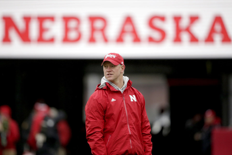 Photo - FILE - In this Nov. 29, 2019, file photo, Nebraska head coach Scott Frost watches warm-ups before an NCAA college football game against Iowa in Lincoln, Neb. The Cornhuskers are 9-15 in his first two seasons, including just 4-8 against Big Ten West opponents and only two road wins. A trendy pick to win the West in 2019, Nebraska finished fifth, and its 5-7 record caused hopes for a quick turnaround to fade. (AP Photo/Nati Harnik, File)