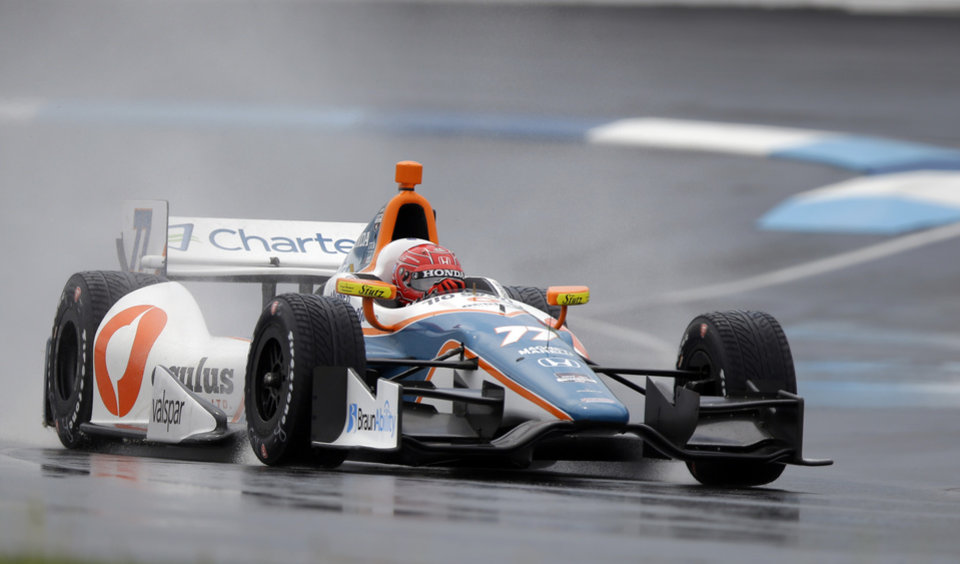 Photo - Simon Pagenaud, of France, heads into turn 2 during qualifications for the inaugural Grand Prix of Indianapolis IndyCar auto race at the Indianapolis Motor Speedway in Indianapolis, Friday, May 9, 2014. (AP Photo/Michael Conroy)