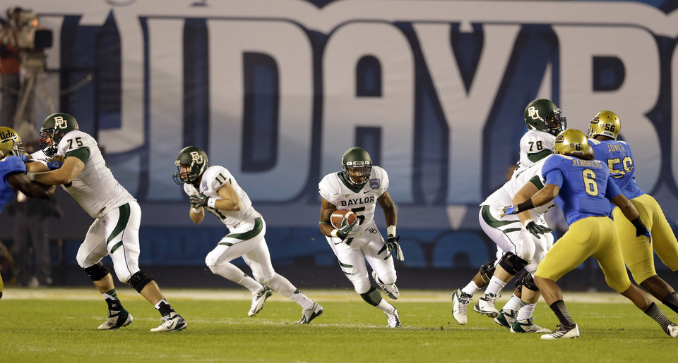 Baylor's Antwan Goodley runs through a hole in the UCLA defense during the first half of the NCAA college football Holiday Bowl game, Thursday Dec. 27, 2012, in San Diego. (AP Photo/Lenny Ignelzi)
