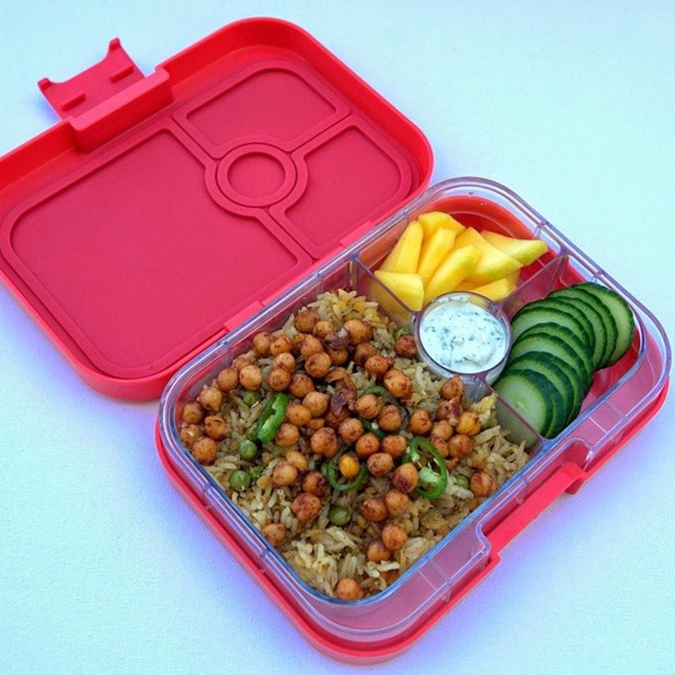 Photo - This undated photo provided by Daniela Devitt and posted in March 2014 to the Instagram account of her company, YUMBOX, shows a Yumbox with masala chickpeas, jalapenos, sliced mango, cucumbers and dill yogurt dip. (AP Photo/Courtesy Daniela Devitt)