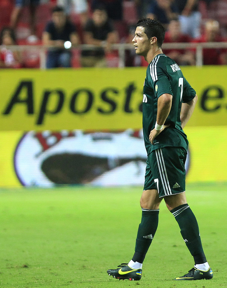 Photo -   Real Madrid's Cristiano Ronaldo from Portugal reacts during the team's La Liga soccer match against Sevilla at the Ramon Sanchez Pizjuan stadium, in Seville, Spain on Saturday, Sept. 15, 2012. Sevilla won the match 1-0. (AP Photo/Angel Fernandez)