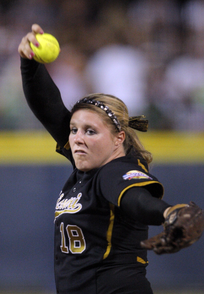 Missouri's Chelsea Thomas (18) pitches during the Women's College World Series game between Baylor and Missouri at the ASA Hall of Fame Stadium in Oklahoma City, Saturday, June 4, 2011. Photo by Sarah Phipps, The Oklahoman