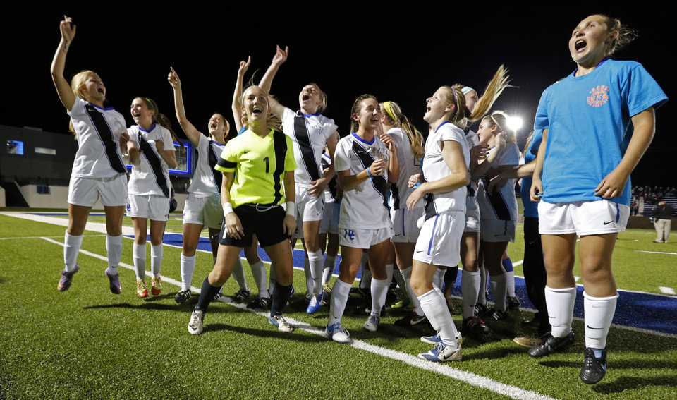 Photo - Deer Creek players celebrate their championship in the Class 5A girls state soccer championship game between Deer Creek and Carl Albert on Friday, May 10, 2013 in Noble, Okla.  Photo by Steve Sisney, The Oklahoman