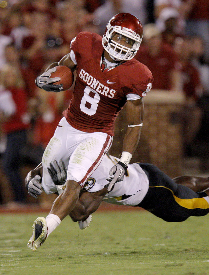 Photo - Oklahoma's Dominique Whaley (8) runs during the Sooners game vs. Missouri. Photo by Bryan Terry, The Oklahoman