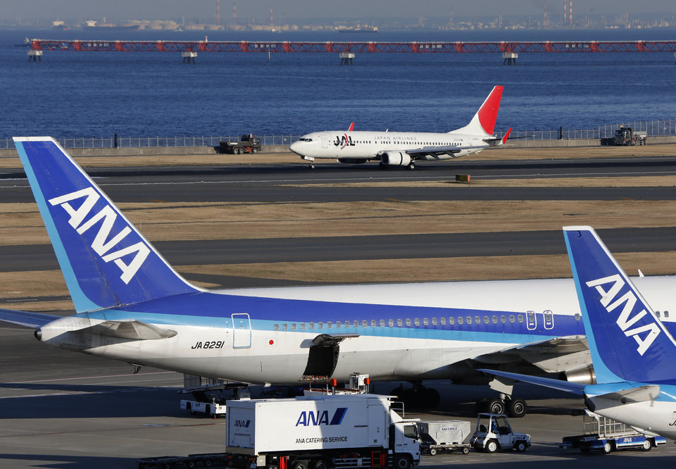 Photo - In this Jan. 30, 2013 photo, All Nippon Airways passenger planes park on the tarmac of Haneda Airport in Tokyo.  Japan's All Nippon Airways is prepared to recoup from Boeing whatever damages it suffers from flight cancellations and other costs caused by the worldwide grounding of 787 jets, a senior executive said Thursday, Jan. 31, 2013.  (AP Photo/Shizuo Kambayashi)
