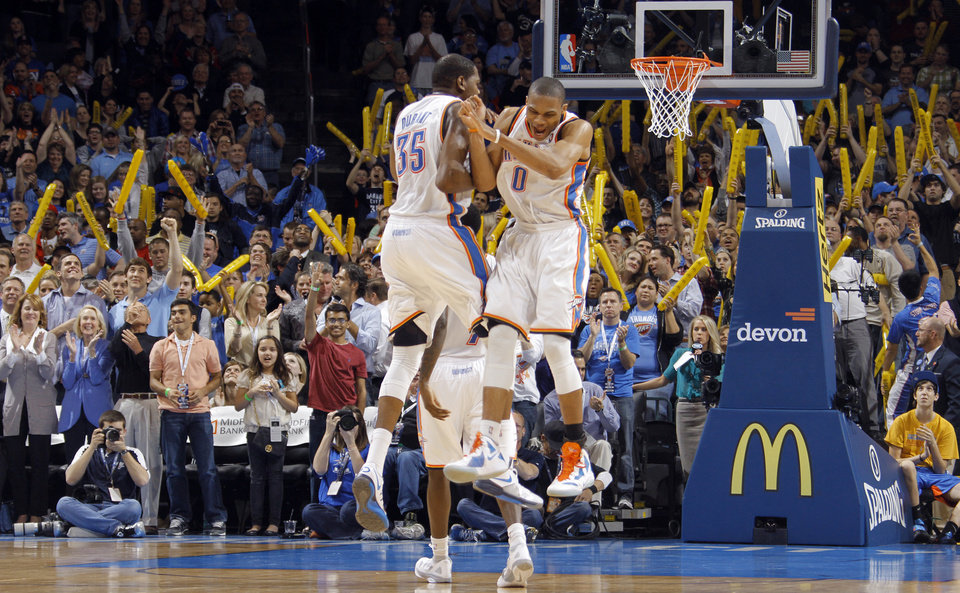 Photo - Oklahoma City Thunder small forward Kevin Durant (35) and Oklahoma City Thunder point guard Russell Westbrook (0) react after Westbrook's three pointer to seal the 115-104 win over Phonenix during the NBA basketball game between the Oklahoma City Thunder and the Phoenix Suns at the Chesapeake Energy Arena on Wednesday, March 7, 2012 in Oklahoma City, Okla.  Photo by Chris Landsberger, The Oklahoman