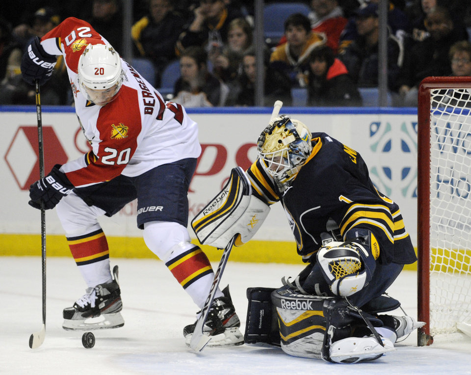 Photo - Florida Panthers' Sean Bergenheim (20), of Finland, shoots the puck against Buffalo Sabres' Jhonas Enroth (1), of Sweden, during the second period of an NHL hockey game in Buffalo, N.Y., Thursday, Jan. 9, 2014. (AP Photo/Gary Wiepert)