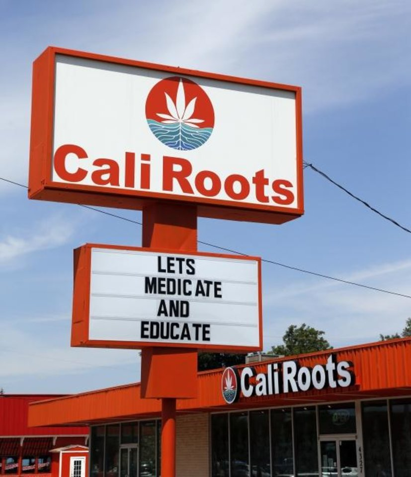 Photo -  Cali Roots, one of the Oklahoma City metro area's many medical cannabis dispensaries, is shown at 4327 NW 23 St. Dispensaries are allowed to provide curbside service during the COVID-19 pandemic, but home deliveries are not allowed. [Nate Billings/The Oklahoman Archives]