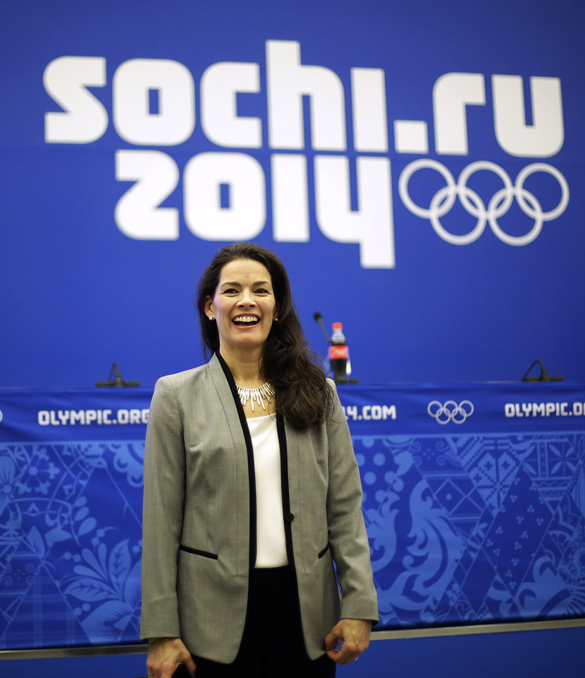 Photo - Former Olympic figure skater Nancy Kerrigan speaks after a screening of a new documentary about the 1994 attack on her which will air the day of the 2014 Winter Olympics closing ceremony, Friday, Feb. 21, 2014, in Sochi, Russia. Kerrigan has been reluctant to talk about rival Tonya Harding's ex-husband hiring a hit squad to take her out before the 1994 Olympics in Lillehammer. She finally relented for a show that marks the 20-year anniversary of the incident, which thrust figure skating into the spotlight and spawned an international media frenzy. (AP Photo/David Goldman)