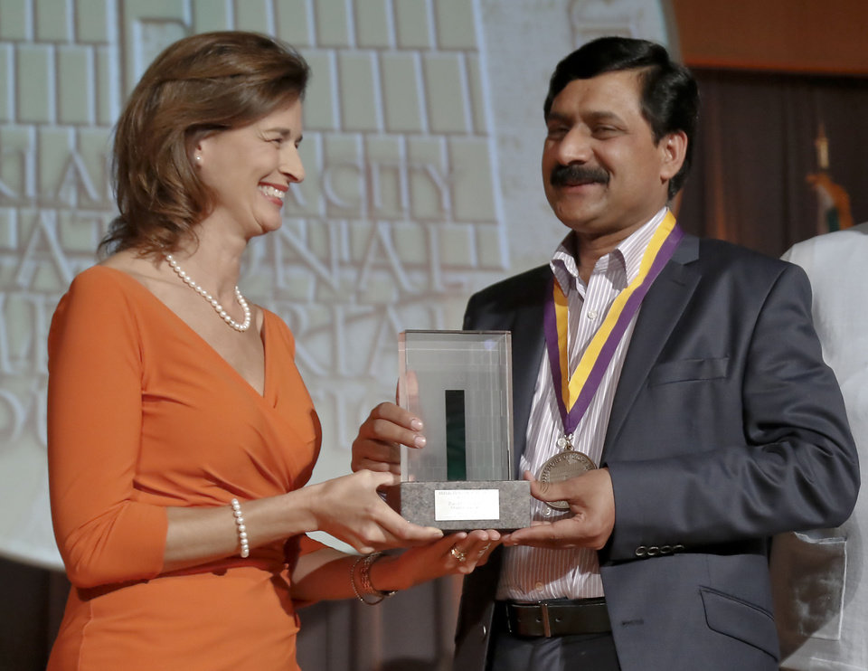 Ann-Clore Duncan presents Ziauddin Yousafzai with the Reflections of Hope Award during a ceremony on Monday, May 13, 2013 in Oklahoma City, Okla. where Malala Yousafzai and her father Ziauddin were honored with the award for Malala\'s stand against the Taliban to have the right to an educated. Photo by Chris Landsberger, The Oklahoman