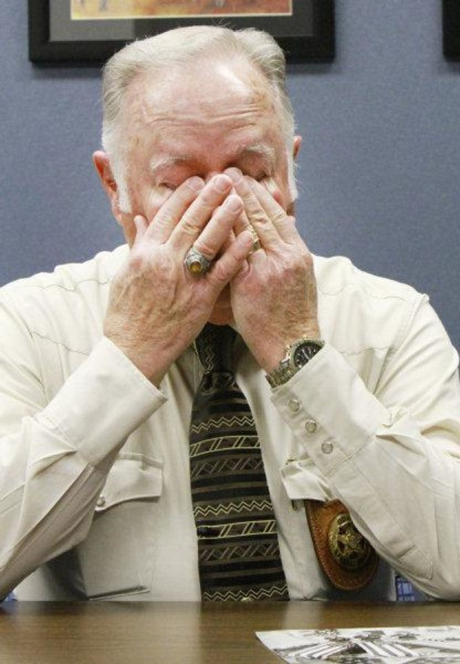 Photo - Retired Oklahoma State Trooper Col. Mike Grimes covers his eyes as he talks about his brother Lt. Pat Grimes who was killed in 1978 while trying to apprehend two prison escapees from McAlester, Friday, December 2 , 2011.       Photo by David McDaniel, The Oklahoman  ORG XMIT: KOD