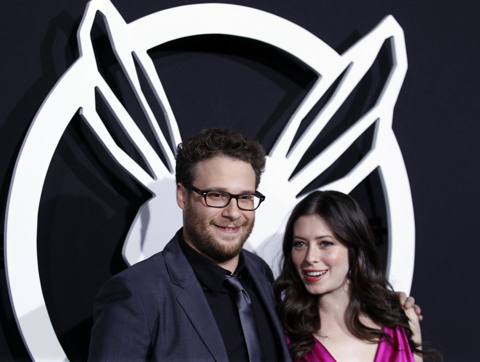 Photo - Cast member Seth Rogen, left, and Lauren Miller arrive at the premiere