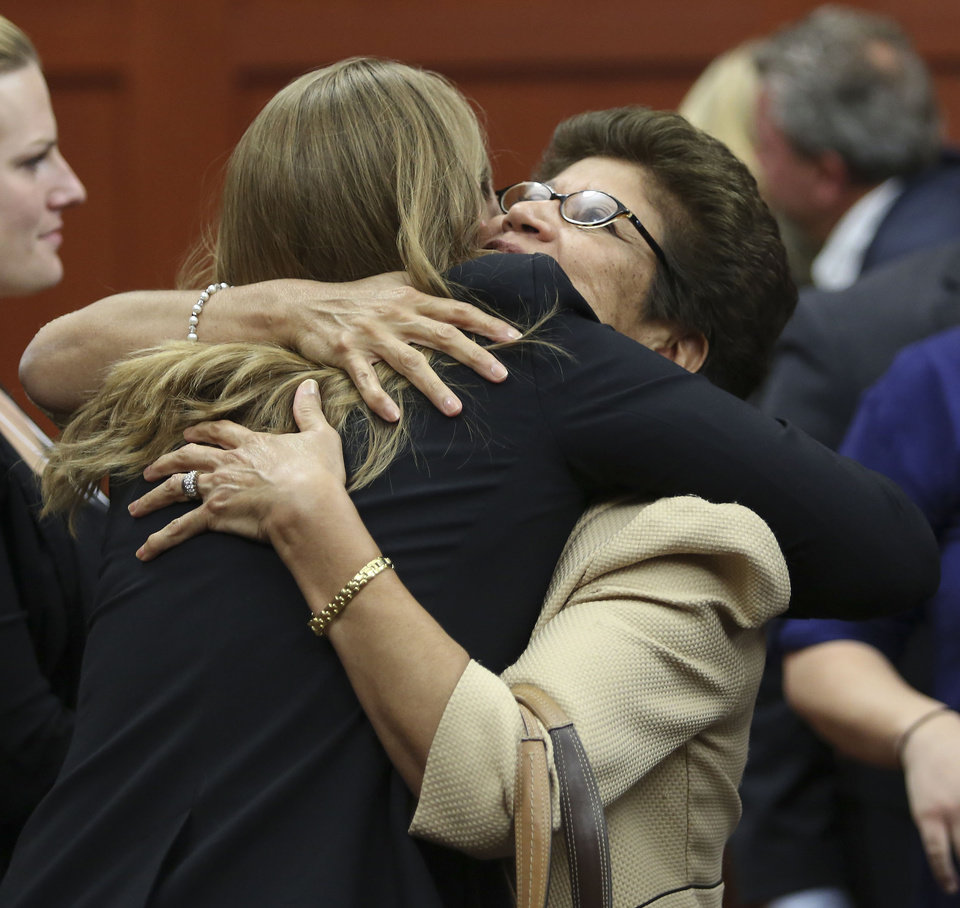 George Zimmerman's family, including Gladys Zimmerman, center, celebrate following George Zimmerman's not guilty verdict in Seminole circuit court in Sanford, Fla. on Saturday, July 13, 2013. Jurors found Zimmerman not guilty of second-degree murder in the fatal shooting of 17-year-old Martin in Sanford, Fla. The six-member, all-woman jury deliberated for more than 15 hours over two days before reaching their decision Saturday night. (AP Photo/Gary W. Green, Pool) ORG XMIT: FLJR404