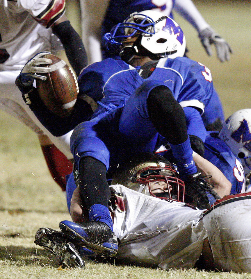 Photo - Millwood's Cameron Batson is brought down by Lincoln Christian's Zack Simmons during a Class 2A high school football playoff game between Millwood and Lincoln Christian in Oklahoma City, Friday, Nov. 25, 2011. Photo by Bryan Terry, The Oklahoman