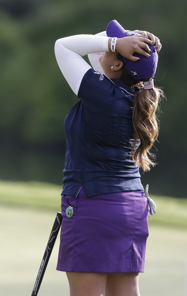 Photo - Lizette Salas celebrates winning the Kingsmill Championship golf tournament at the Kingsmill resort  in Williamsburg, Va., Sunday, May 18, 2014.  Salas won her first LPGA event after shooting an even par-71 leaving her at 13-under for the tournament.  (AP Photo/Steve Helber)