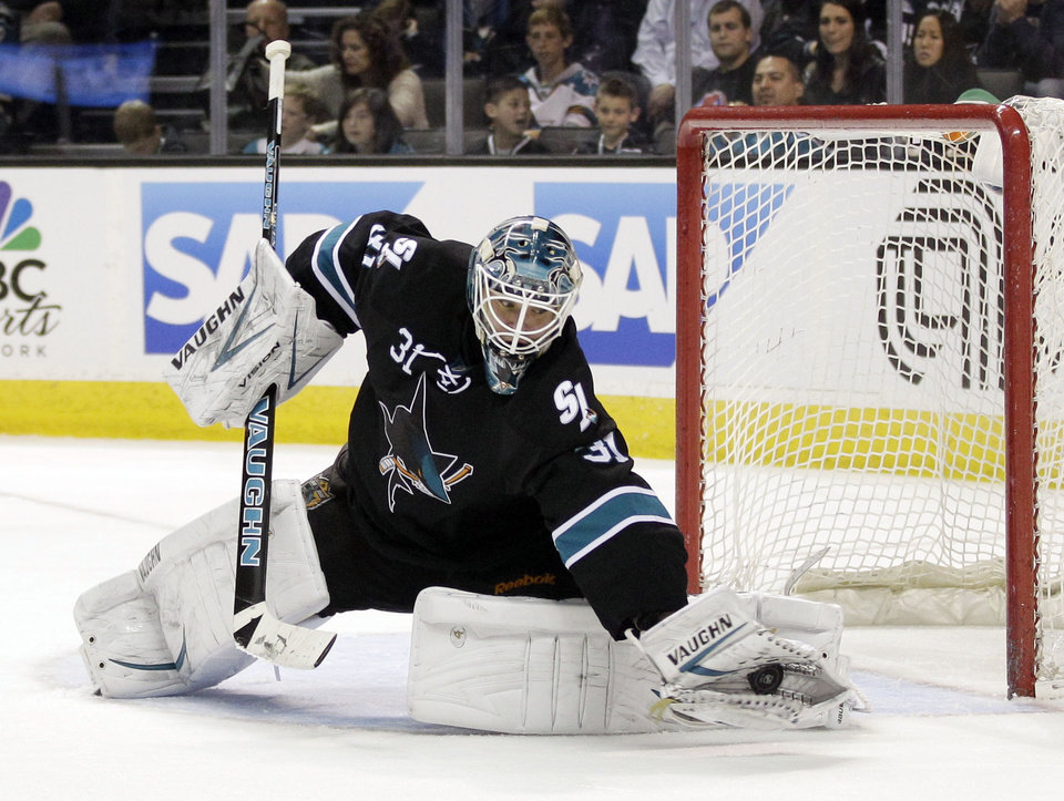 San Jose Sharks goalie Antti Niemi, of Finland, deflects a shot on goal against the Los Angeles Kings during the scond period of an NHL hockey game Saturday, April 7, 2012 in San Jose, Calif. (AP Photo/Marcio Jose Sanchez)