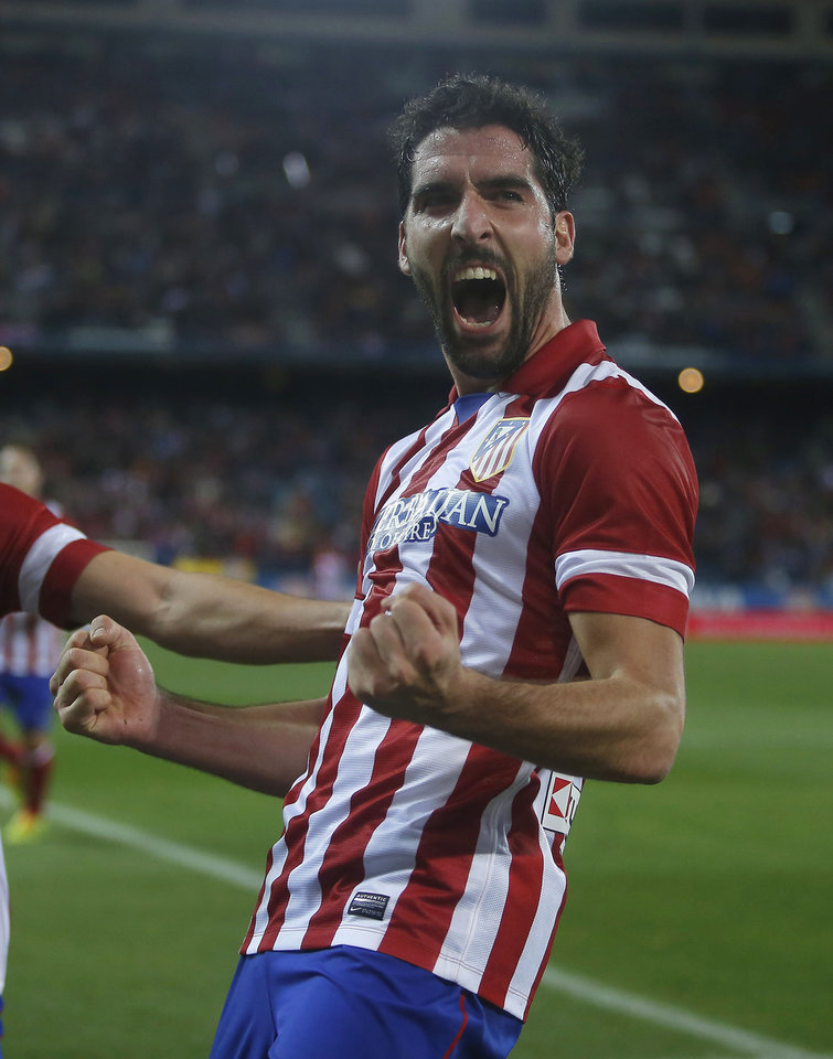 Photo - Atletico's Raul Garcia celebrates his goal during a Spanish Copa del Rey soccer match between Atletico de Madrid and Valencia at the Vicente Calderon stadium in Madrid, Spain, Tuesday, Jan. 14, 2014. (AP Photo/Andres Kudacki)