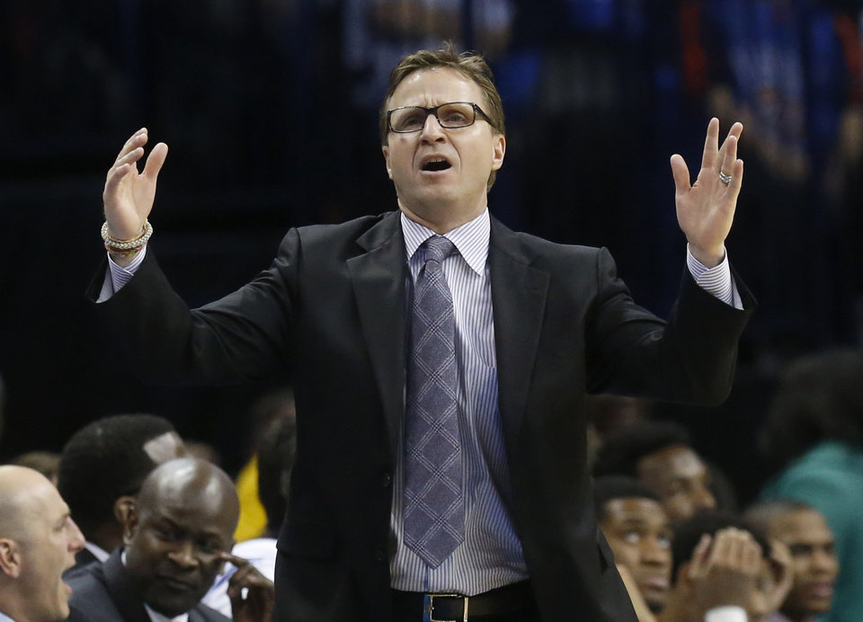 Oklahoma City Thunder head coach Scott Brooks reacts to a call in the third quarter of an NBA basketball game against the Portland Trail Blazers in Oklahoma City, Tuesday, Jan. 21, 2014. Oklahoma City won 105-97. (AP Photo/Sue Ogrocki)
