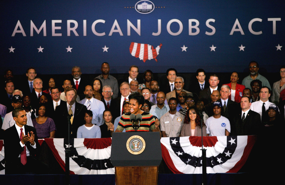 Photo - FILE- In this Wednesday, Oct. 19, 2011,  file photo, First lady Michelle Obama promotes the American Jobs Act, while at a stop at Joint Base Langley-Eustis, in Hampton, Va. The JOBS Act allows companies to raise up to $1 million a year. (AP Photo/Jason Hirschfeld)