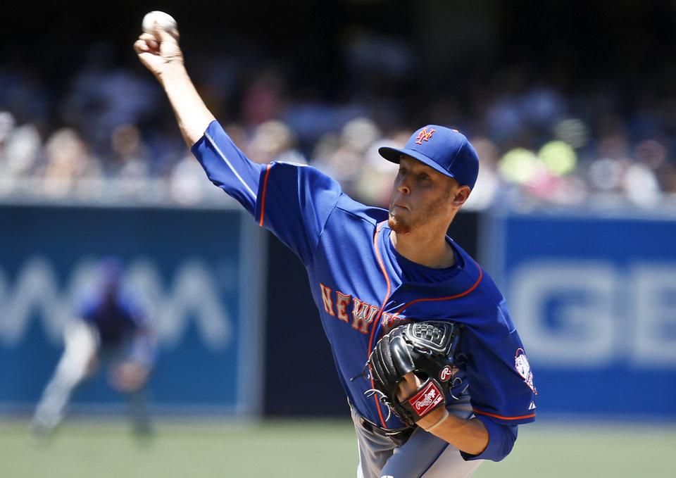 Photo - New York Mets starting pitcher Zack Wheeler throws against the San Diego Padres in the first inning of a baseball game Sunday, July 20, 2014, in San Diego.  (AP Photo/Lenny Ignelzi)