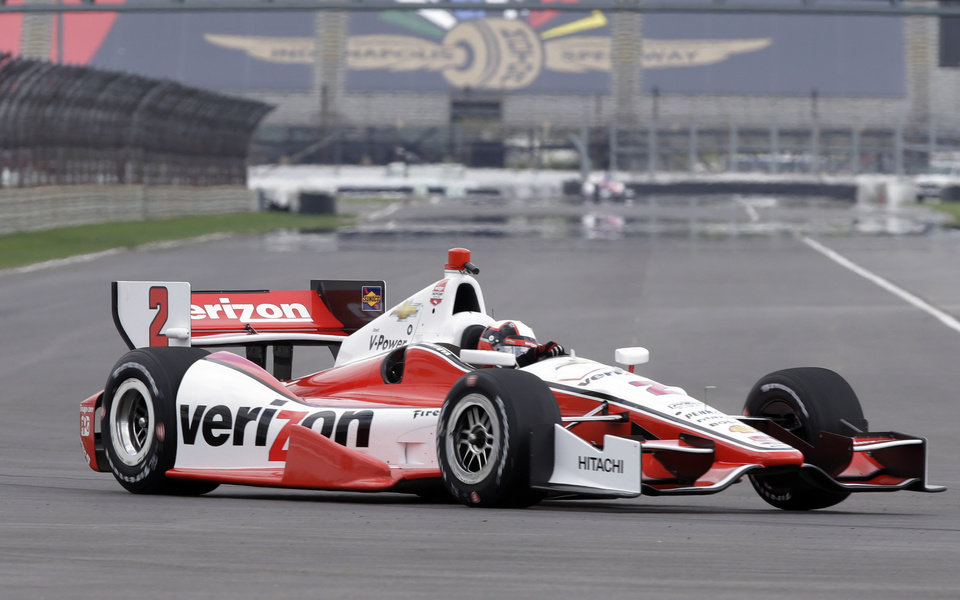 Photo - Former Indy 500 champion Juan Pablo Montoya, of Colombia, takes a turn during testing for the inaugural Grand Prix of Indianapolis auto race on the new road course at the Indianapolis Motor Speedway in Indianapolis, Wednesday, April 30, 2014. (AP Photo/Michael Conroy)