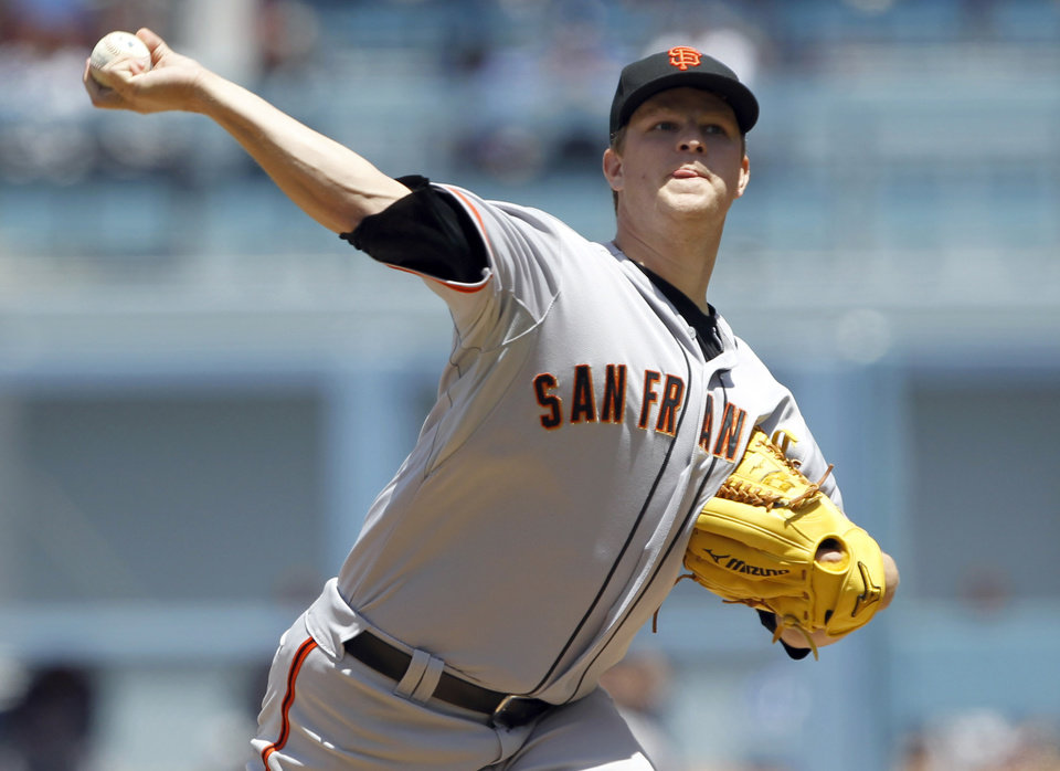 Photo - San Francisco Giants starting pitcher Matt Cain throws against the Los Angeles Dodgers in the first inning of a baseball game on Saturday, May 10, 2014, in Los Angeles. (AP Photo/Alex Gallardo)