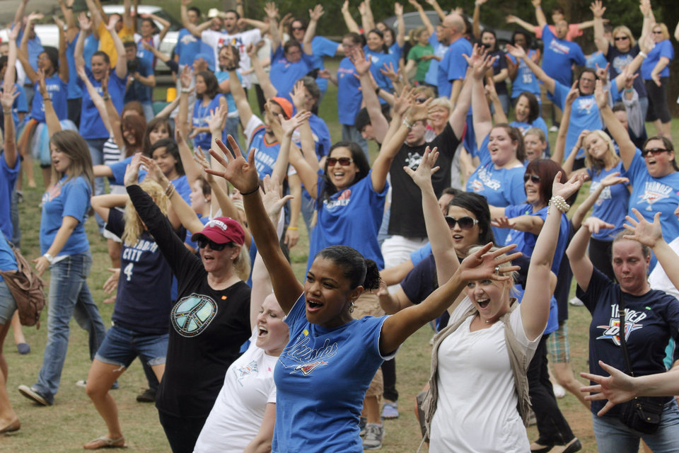The crowd practices the dance steps during a Thunder mob dance to send to Ellen DeGeneres at Hafer Park in Edmond Wednesday, May 18, 2011. Photo by Doug Hoke, The Oklahoman.