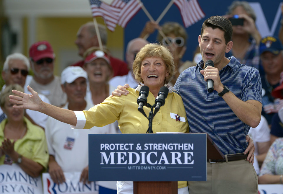 Republican vice-presidential candidate Rep. Paul Ryan, R-Wis., right, introduces his mother, Betty Ryan Douglas, to supporters at a campaign rally in The Villages, Fla., Saturday, Aug. 18, 2012.(AP Photo/Phelan M. Ebenhack)