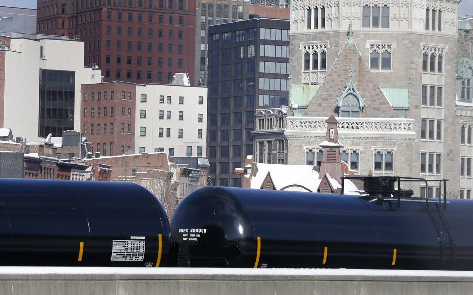 Photo - Railroad oil tanker cars are parked along Interstate 787 in downtown Albany, N.Y., on Friday, Feb. 7, 2014. The Port of Albany has become a hub for the U.S. oil business, taking shipments from North Dakota's Bakken Shale daily by mile-long trains and shipping it in tankers down the Hudson River to refineries. Opponents of a proposal to build boilers to liquefy heavy crude passing through Albany by rail are drawing attention to the capital's emergence as a major hub for the transport of oil that's widely considered risky from an environmental and safety standpoint.  (AP Photo/Mike Groll)
