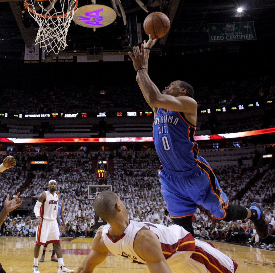 Oklahoma City's Russell Westbrook (0) runs into Miami's Shane Battier (31) during Game 5 of the NBA Finals between the Oklahoma City Thunder and the Miami Heat at American Airlines Arena, Thursday, June 21, 2012. Oklahoma City lost 121-106. Photo by Bryan Terry, The Oklahoman