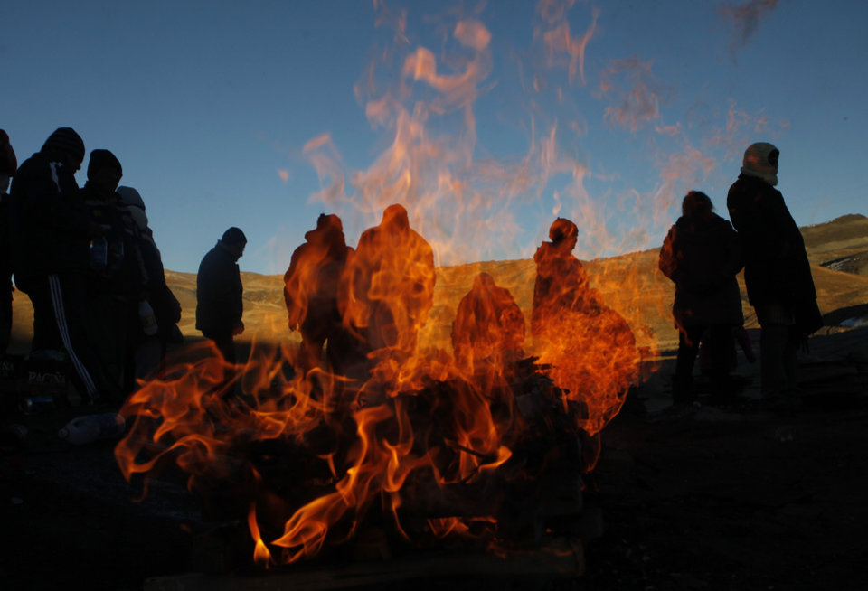 Photo - AP10ThingsToSee - People burn offerings to