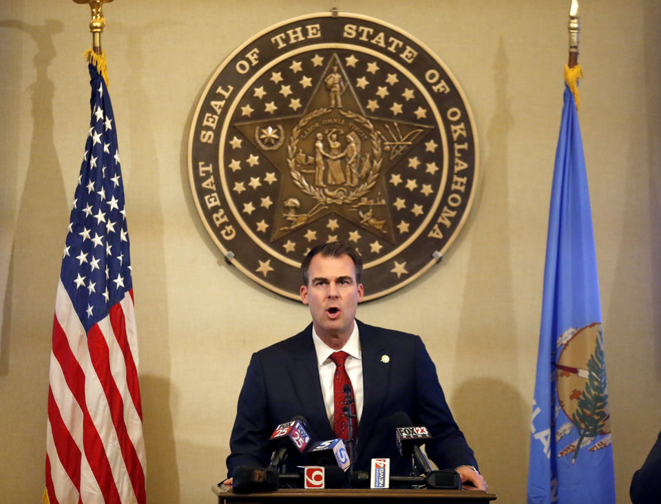 Photo - Gov. Kevin Stitt speaks during a press conference at the state Capitol in Oklahoma City, Wednesday, April 22, 2020. [Sarah Phipps/The Oklahoman]