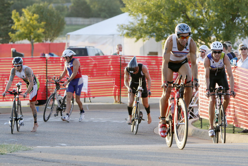 David Jones transitions from swimming to biking during the Redman Triathlon in Oklahoma City, OK, Saturday, September 22, 2012,  By Paul Hellstern, The Oklahoman