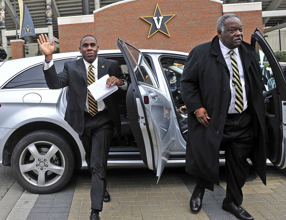 Photo - Derek Mason, left, arrives with athletic director David Williams for a news conference to introduce Mason as the new Vanderbilt football coach Saturday, Jan. 18, 2014, in Nashville, Tenn. Mason was previously the defensive coordinator at Stanford. (AP Photo/The Tennessean, Jae S. Lee) NO SALES