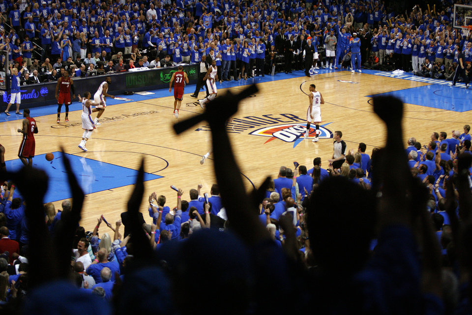 Fans celebrate during the final seconds of Game 1 of the NBA Finals between the Oklahoma City Thunder and the Miami Heat at Chesapeake Energy Arena in Oklahoma City, Tuesday, June 12, 2012. Photo by Sarah Phipps, The Oklahoman