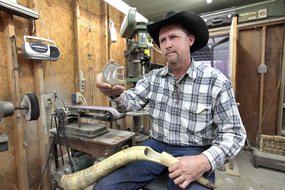 Ranch foreman James Coldren with a belt buckle made from cattle horns on a ranch near Foraker.  <strong>David McDaniel - The Oklahoman</strong>