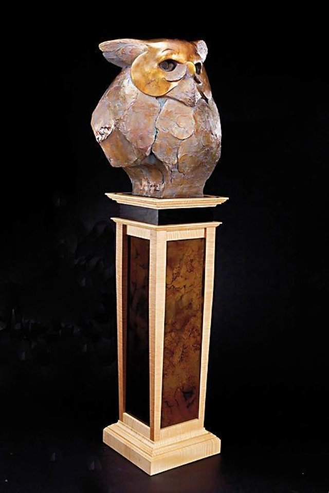 Photo - ?Wise Guy,? a bronze sculpture by Tim Cherry, is priced at $13,900 and stands nearly six-feet-tall. The artwork's pedestal was designed and hand-made by a Colorado furniture-builder and design friend of Cherry's. PHOTO PROVIDED