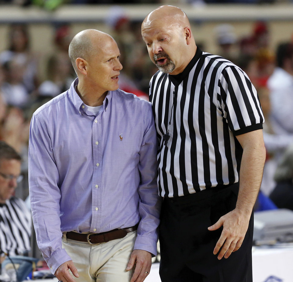 Photo - Anadarko head coach Jeff Zinn shares a comment with one of the officials during the Class 4A State championship game between Ft. Gibson and Anadarko at Jim Norick Arena at State Fair Park  on Saturday, Mar. 15, 2014. Ft. Gibson came from behind much of the second half to win 50-47.  Photo by Jim Beckel, The Oklahoman