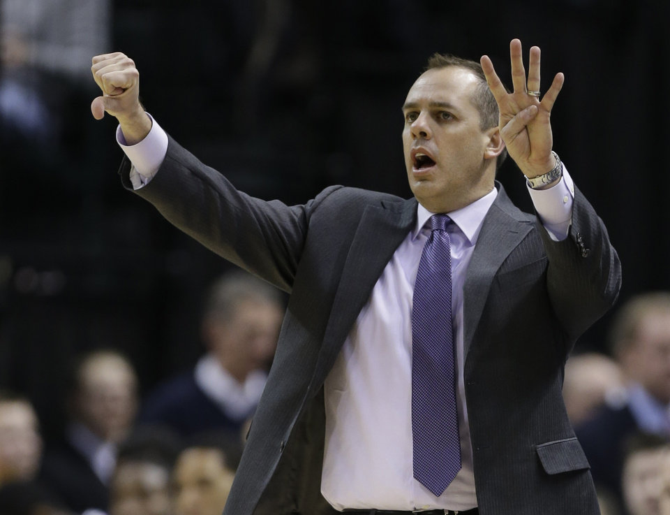 Photo - Indiana Pacers head coach Frank Vogel calls a play to his team in the second half of an NBA basketball game against the Denver Nuggets in Indianapolis, Monday, Feb. 10, 2014. The Pacers won 119-80. (AP Photo/Michael Conroy)