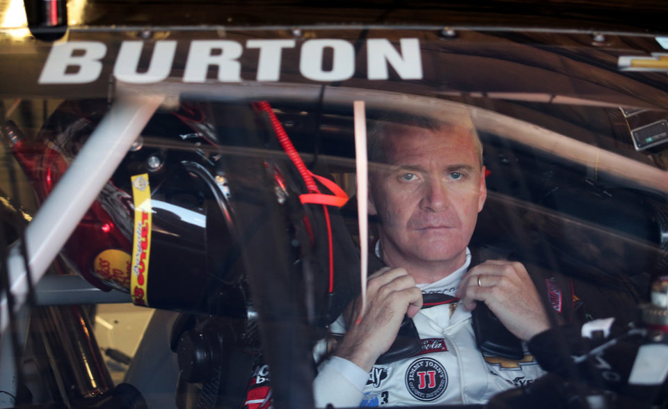 Photo - Jeff Burton gets prepared before practice for the NASCAR Sprint Cup Series auto race at Michigan International Speedway in Brooklyn, Mich., Friday, Aug. 15, 2014. A