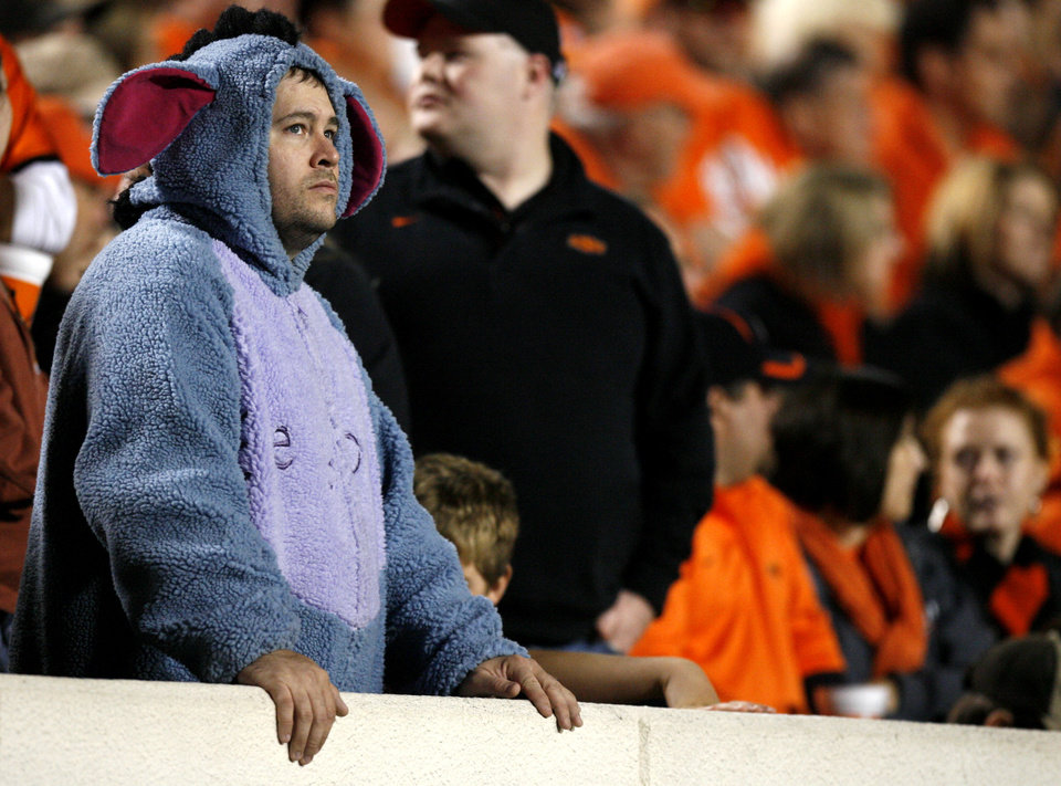 Photo - Clint Miller of Tulsa, Okla., watches in as the Cowboys lose to the Longhorns during the college football game between the Oklahoma State University Cowboys (OSU) and the University of Texas Longhorns (UT) at Boone Pickens Stadium in Stillwater, Okla., Saturday, Oct. 31, 2009. Photo by Sarah Phipps, The Oklahoman