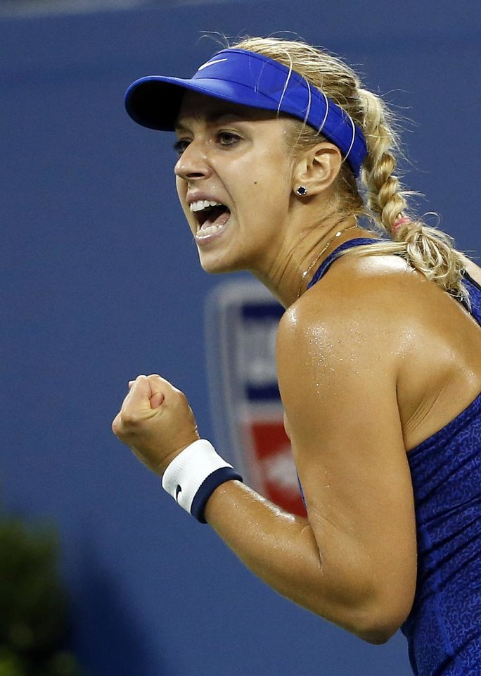 Photo - Sabine Lisicki, of Germany, reacts after winning a game against Maria Sharapova, of Russia, during the third round of the U.S. Open tennis tournament Friday, Aug. 29, 2014, in New York. (AP Photo/Jason DeCrow)