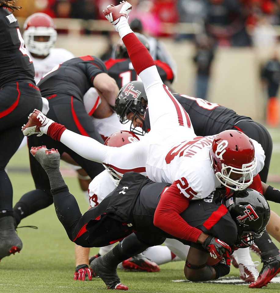 Photo - Oklahoma's Aaron Franklin (25) brings down Texas Tech's SaDale Foster (8) during a college football game between the University of Oklahoma (OU) and Texas Tech University at Jones AT&T Stadium in Lubbock, Texas, Saturday, Oct. 6, 2012. Oklahoma won 41-20. Photo by Bryan Terry, The Oklahoman