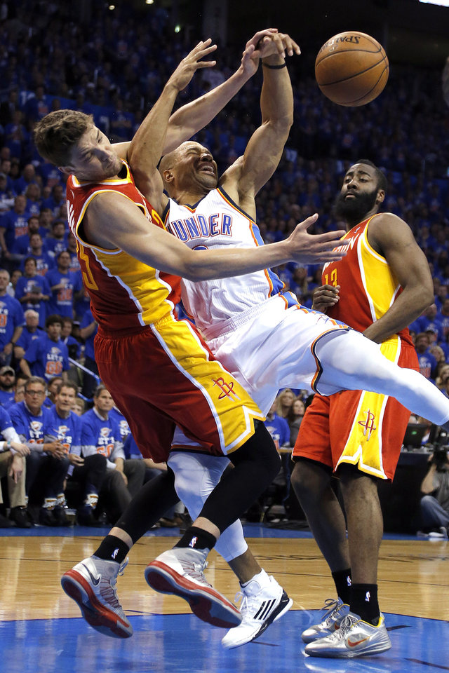 Oklahoma City\'s Derek Fisher (6) is called for a charing foul as Houston\'s Chandler Parsons (25) defends during Game 5 in the first round of the NBA playoffs between the Oklahoma City Thunder and the Houston Rockets at Chesapeake Energy Arena in Oklahoma City, Wednesday, May 1, 2013. Photo by Sarah Phipps, The Oklahoman