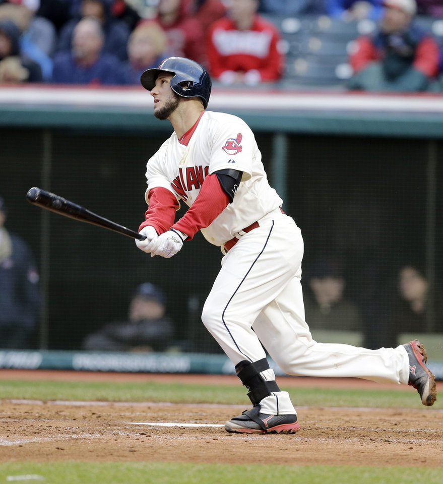 Photo - Cleveland Indians' Yan Gomes watches his ball after hitting a solo home run off Minnesota Twins starting pitcher Mike Pelfrey in the sixth inning of a baseball game, Friday, April 4, 2014, in Cleveland. (AP Photo/Mark Duncan)