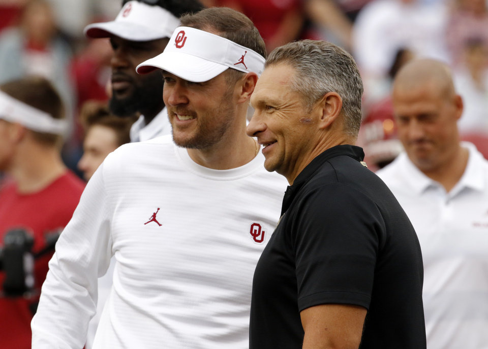 Photo - Sooner head coach Lincoln Riley and Army head coach Jeff Monken speak before a college football game between the University of Oklahoma Sooners (OU) and the Army Black Knights at Gaylord Family-Oklahoma Memorial Stadium in Norman, Okla., on Saturday, Sept. 22, 2018. Photo by Steve Sisney, The Oklahoman
